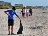 Image: People picking up trash on beach