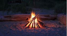 Log fire on the beach